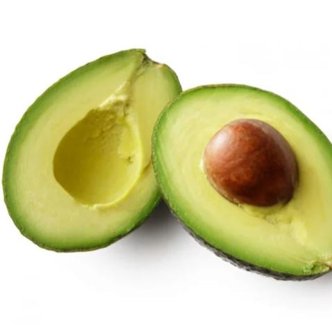 Зелёный спелый авокадо